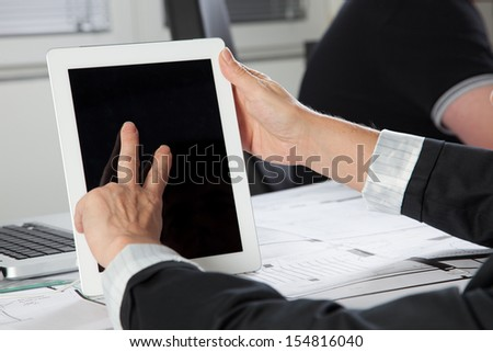 A gesture on a Tablet PC with two Fingers in a vertical position. - stock photo