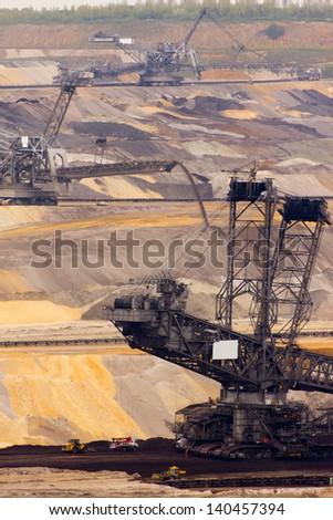 A giant bucket-wheel excavator in a brown-coal mine - stock photo
