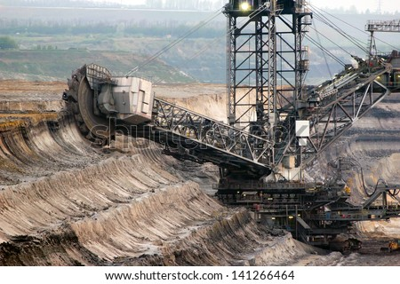 A giant bucket-wheel excavator in a brown-coal mine - stock photo