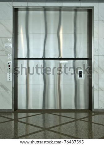 A giant cargo elevator in a modern building - stock photo