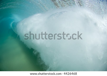a giant wave from behind - stock photo