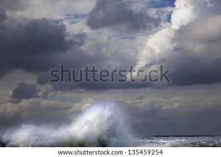 "A giant wave raising above the sea's water surface, encouraged by the mighty wind to touch the heavily overcast winter sky; just like in ""The Creation of Adam"" on the ceiling of the sistine chapel."