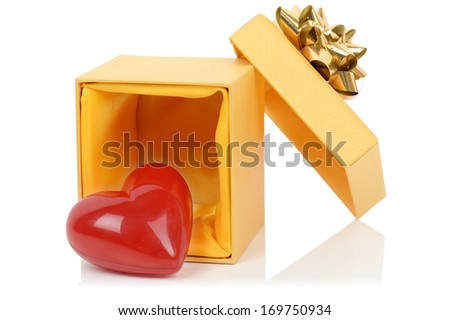 A gift of love a heart in a box isolated on a white background - stock photo