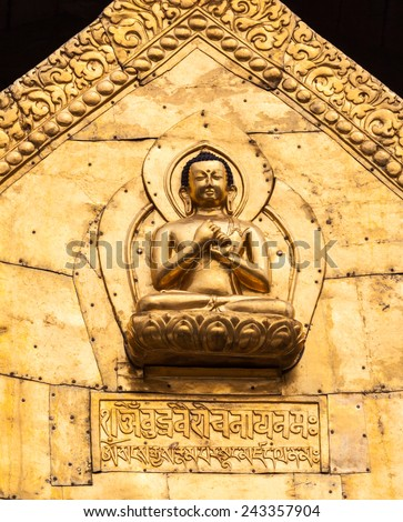 A gilded Buddha on a temple roof - stock photo