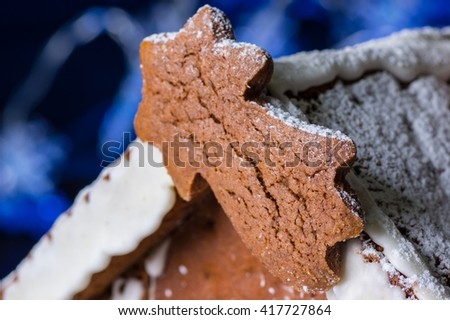 a gingerbread house decorated by sugar - stock photo