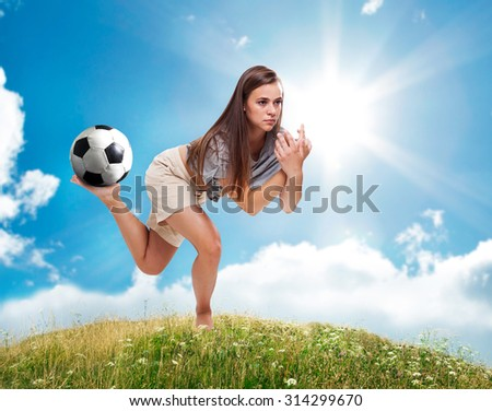 A girl and a ball. - stock photo