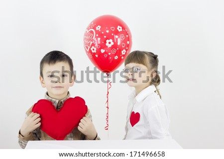 a girl and a boy who holds plush heart,best focus your eyes boy, heart, shirt,soft focus girls and balloon