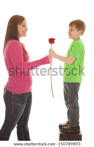 A girl and a young boy both holding onto a rose