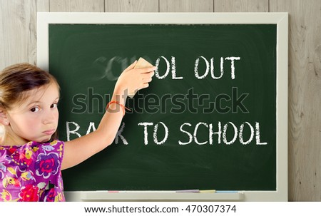 a girl clears school out on green blackboard