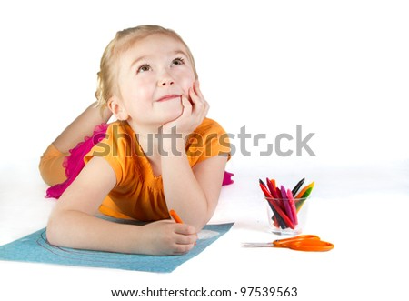 A girl drawing a rainbow, thinking about her work. - stock photo