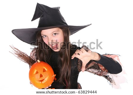 a girl dressed as a witch with a broomstick and a pumpkin-halloween