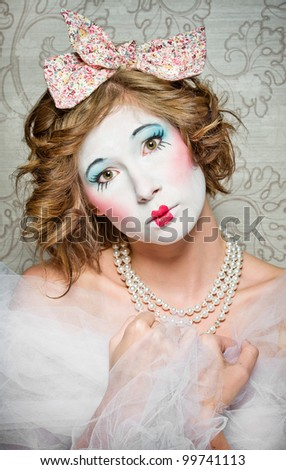 a girl dressed up as an old vintage porcelain doll