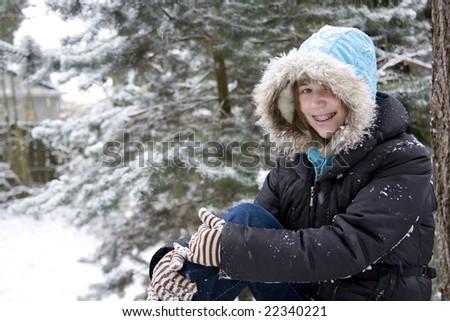 A girl enjoying a snow day - stock photo