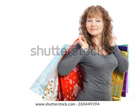a girl enjoys her purchases of - stock photo