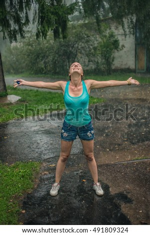 A girl enjoys the rain