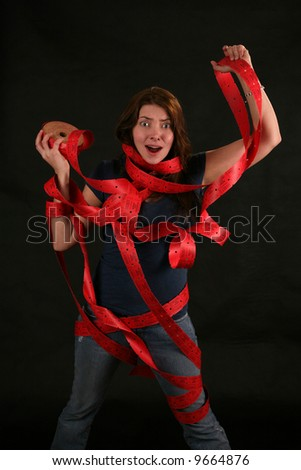 """a girl expresses frustration with the concept of being """"Caught up in Red Tape"""" - stock photo"""