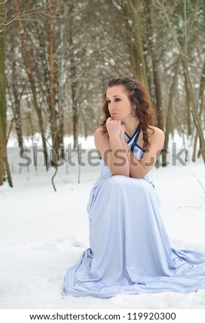 A girl freezes in a dress - stock photo