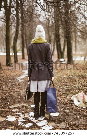 A girl from back, in autumn forest