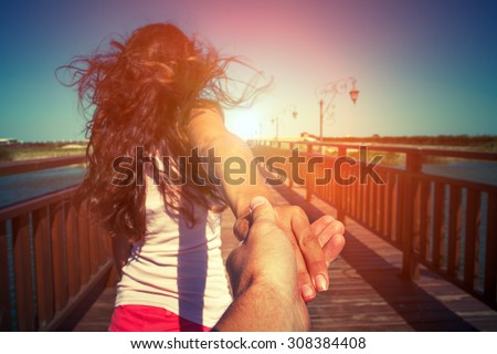 a girl goes on a post holding a fellow on a hand - stock photo