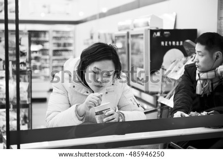 A girl has breakfast in China in the city of Shanghai . 2014. editorial