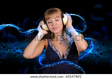 A girl having fun on the background of bright lights in the disco - stock photo