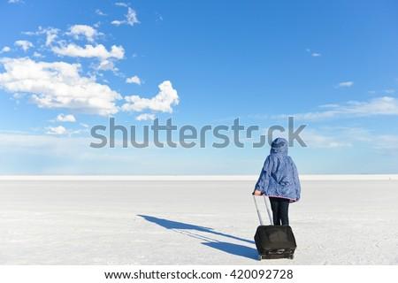 A girl head on horizon on white salt lake - Bonneville, Utah - stock photo
