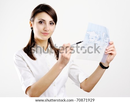 A girl holding a map of the world printed on a transparent material - stock photo
