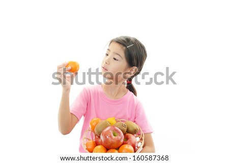 A girl holding fruits - stock photo