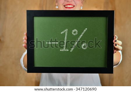 a girl holds a sign saying sale - 1 percent - stock photo