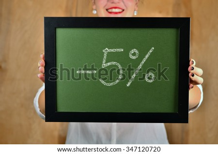 a girl holds a sign saying sale - 5 percent - stock photo