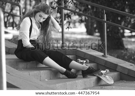 a girl in a classic suit in the park. black and white photo
