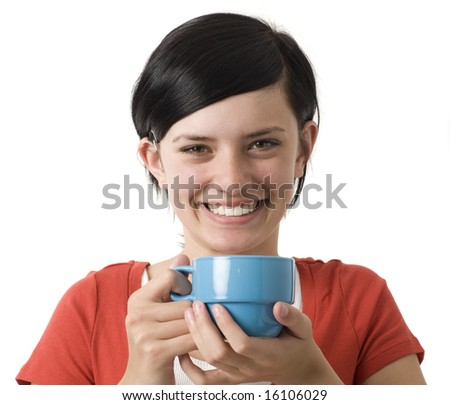 A girl in a red shirt holds a blue cup and smiles
