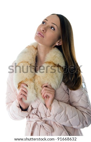 A girl in a warm jacket looking to the side - stock photo