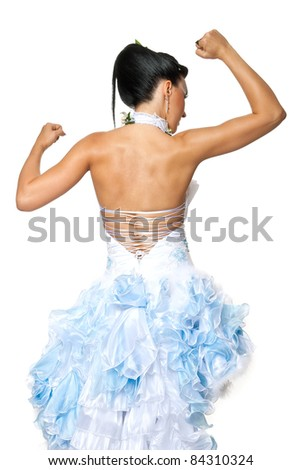 A girl in a wedding dress posing showing showing athletic body in a studio isolated on a white background - stock photo
