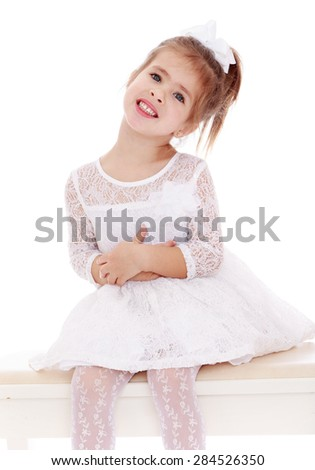 A girl in a white dress- isolated on white background - stock photo