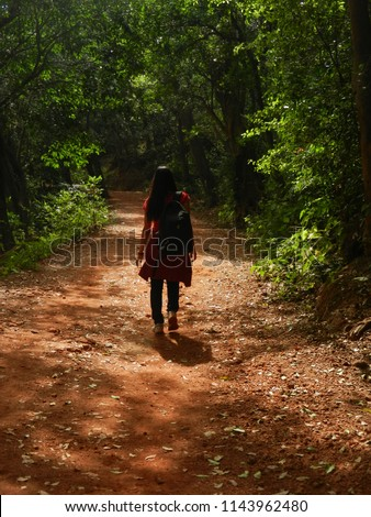 a girl in forest view of matheran hill station with sun shine