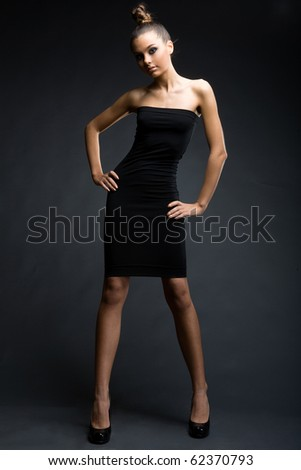 a girl in slinky black dress - stock photo