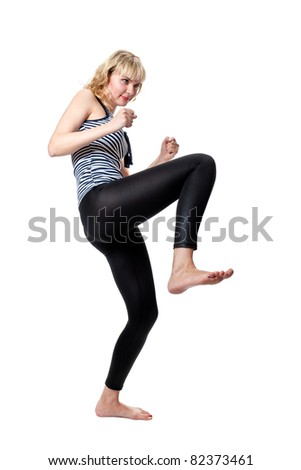 A girl in tight clothes shows military posture. isolated on white - stock photo
