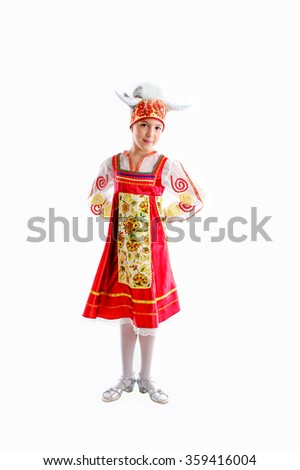 a girl in traditional red and white masquerade costume, little cow - stock photo