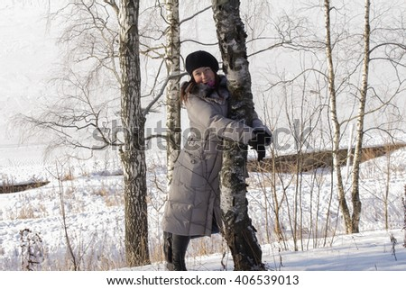 A girl in winter forest