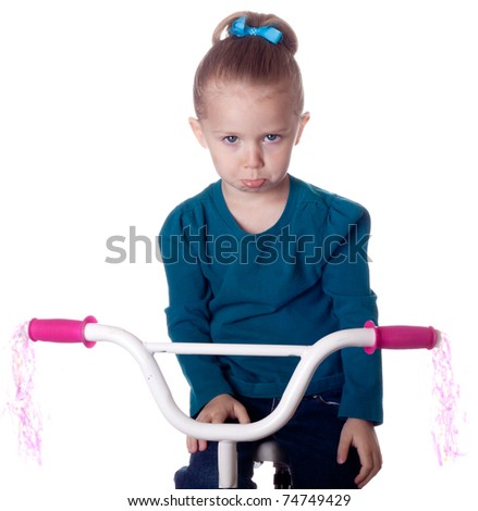 A girl is sad because she has to stop riding her bike. - stock photo