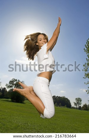A girl jumping in the air. - stock photo