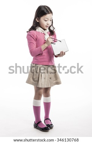 A girl(kid, student, woman, female) wearing pink shirts and ivory skirt hold a white empty paper bag(shopping bag) with smile for gift isolated white. - stock photo