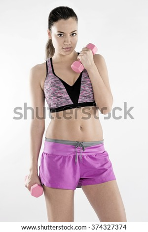 a girl making standing bicep alternate curls  - stock photo