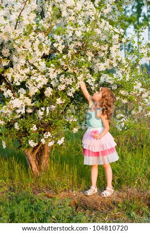 a girl near a flowering tree, spring - stock photo