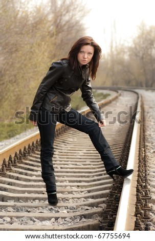 a girl near the railroad - stock photo