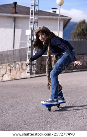 A girl playing with a wave board. Skateboard