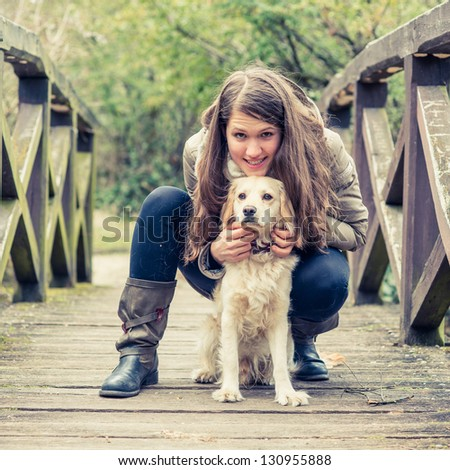 A girl relaxing outside with her dog. - stock photo