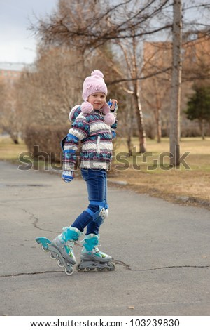 A girl riding a roller in the park