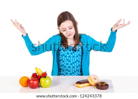 a girl's choice of a healthy or unhealthy snack - stock photo